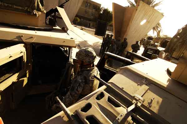 U.S. Army Soldiers assigned to Delta Company, 2nd Combined Arms Battalion, 69th Armor Regiment, prepare to convoy to Combat Outpost Dealer to partake in Thanksgiving dinner, Forward Operating Base Rustamiyah, Baghdad, Iraq, Nov. 22. (U.S. Air Force Photo/Staff Sgt. Jason T. Bailey)
