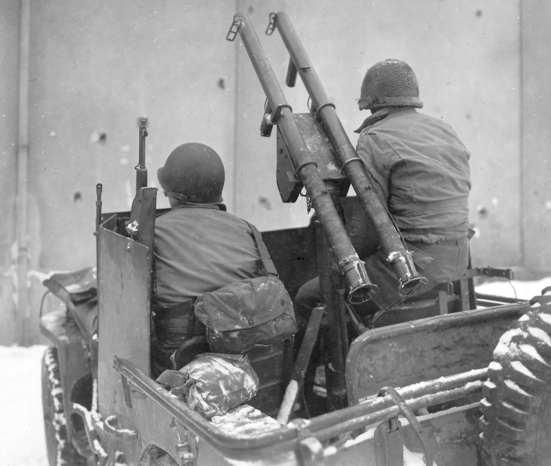 Improvised armored jeep with bazookas.  9th ID in the Battle of the Bulge.