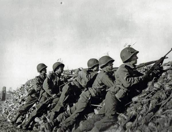 US troops from an airborne anti-tank company in Holland, 1944 scanning the terrain searching for a German machinegun whose crew inconsiderately shot up the American's ride...