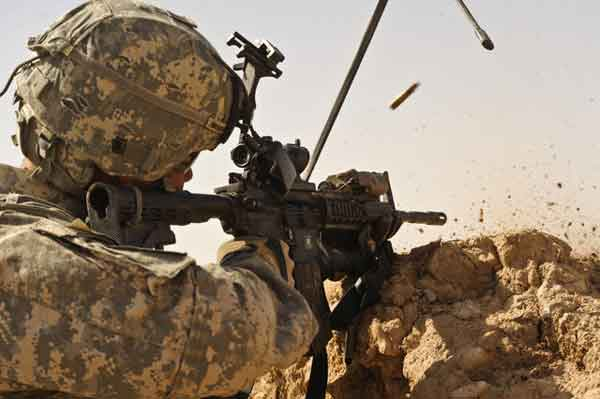02/19/2010 - U.S. Army 2nd Lt. Jesse Underwood engages enemy forces during Operation Moshtarak in Badula Qulp, Afghanistan, Feb. 19, 2010. The International Security Assistance Force operation is an offensive mission being conducted in areas of Afghanistan prevalent in drug-trafficking and Taliban insurgency. Underwood is from Alpha Company, 1st Battalion, 17th Infantry Regiment. (DoD photo by Tech. Sgt. Efren Lopez, U.S. Air Force/Released)